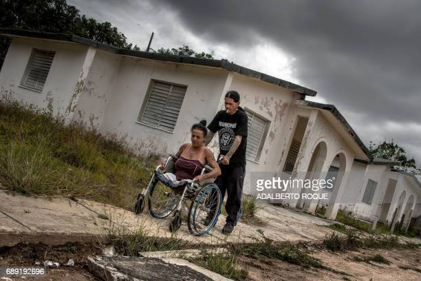 AIDS patients Gerson and Yoandra arrive at their home a former sanatorium for HIV patients in Pinar del Rio province Cuba on April 20 2017 Like many...