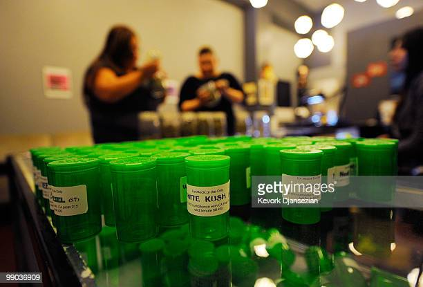 Patients get their prescriptions filled at Sunset Junction medical marijuana dispensary on May 11 2010 in Los Angeles California The dispensary is...