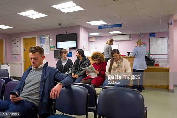 patients in a waiting room - doctor's surgery stock pictures, royalty-free photos & images