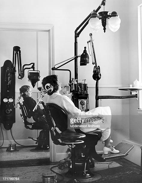 Patients in chairs in a dentist's office, Coral Gables, Florida, circa 1930.