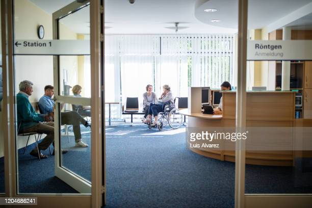 patients in waiting room at hospital - waiting stock pictures, royalty-free photos & images