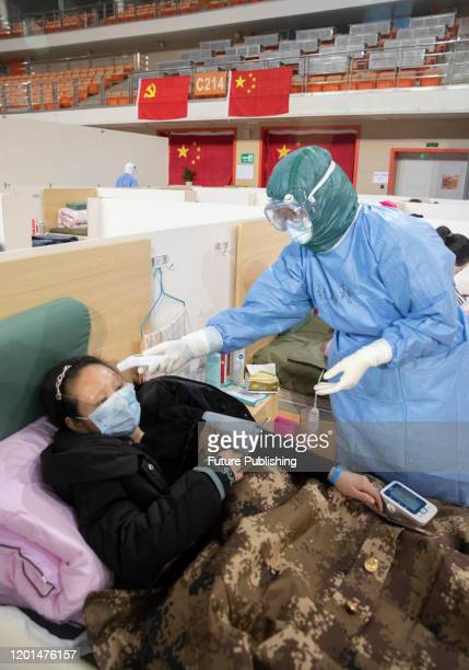 Patients in Wuhan fangcang hospital, Wuhan City, Hubei Province, China, February 14, 2020.- PHOTOGRAPH BY Costfoto / Barcroft Media