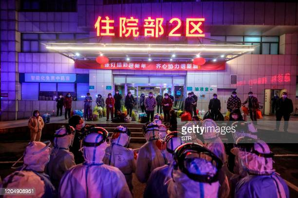 Patients infected by the COVID-19 coronavirus wait to be transferred from Wuhan No.5 Hospital to Leishenshan Hospital, the newly-built hospital for...