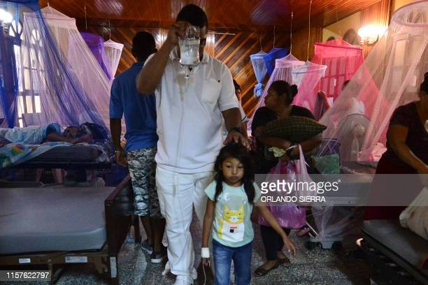 TOPSHOT Patients infected with dengue which vector is the Aedes aegypti are assisted in the chapel of the Roberto Suazo Cordova Hospital in La Paz...