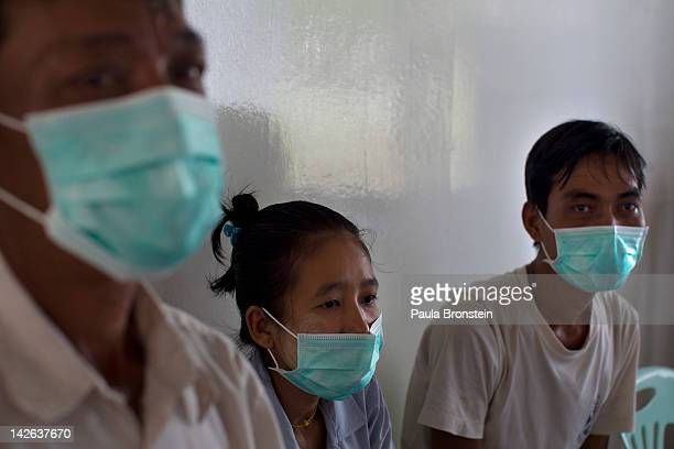 Patients infected with multidrugresistant tuberculosis wear masks as they wait to be seen by medical staff at the Medecins Sans Frontieres HIVAIDS...