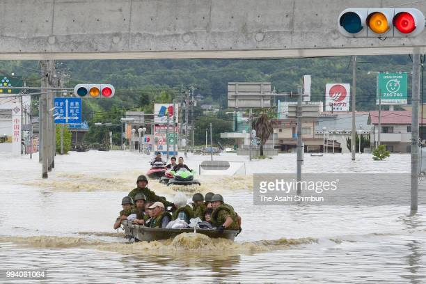 Patients of Mabi Memorial Hospital are rescued by SelfDefense Force members as the Mabicho area is submerged after heavy rain on July 8 2018 in...