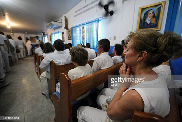 Patients pray before being treated by Brazilian medium Joao de Deus at his 'Casa de Dom Inacio de Loyola' in Abadiania 120km southwest of Brasilia...