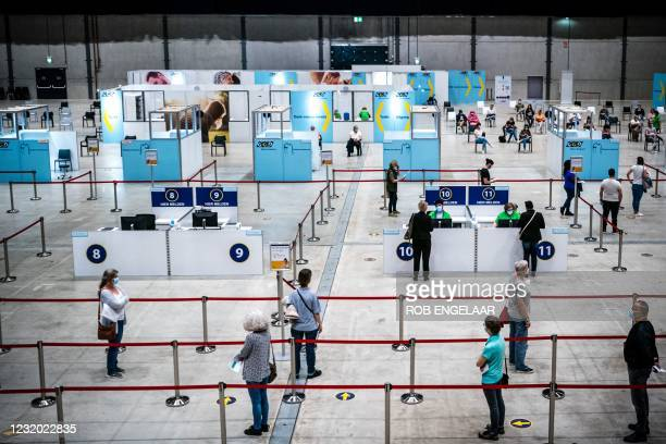 Patients queue at a Covid-19 vaccination centre in Breepark in Breda, on March 30, 2021. - - Netherlands OUT / Netherlands OUT