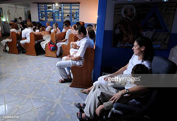 Patients rest at the Joao de Deus office after being treated by the medium in his 'Casa de Dom Inacio de Loyola' in Abadiania 120km southwest of...