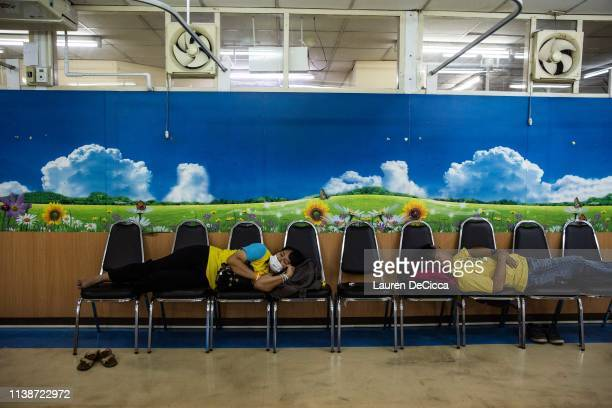 Patients rest inside the clean zone a room with purified air for respirtory illness patients at the Suan Dok Hospital on April 22 2019 in Chiang Mai...