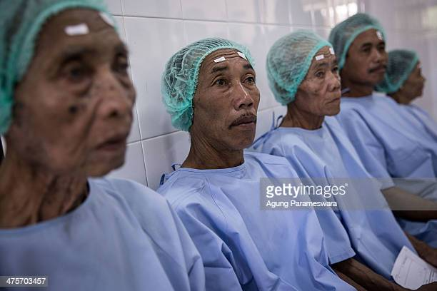 Patients sit as they wait for cataract surgery at Udayana Army Hospital March 1 2014 in Denpasar Bali Indonesia More than 400 patients received free...