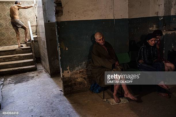 Patients sit at the Kalinina hospital basement after a shelling in the main separatist stronghold Donetsk on August 24 2014 A hospital was hit and...