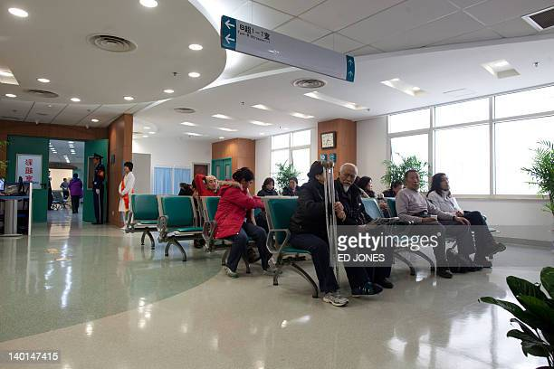 Patients sit in a waiting room at the Beijing Friendship Hospital during a government supervised media tour on February 29 2012 The tour aimed to...