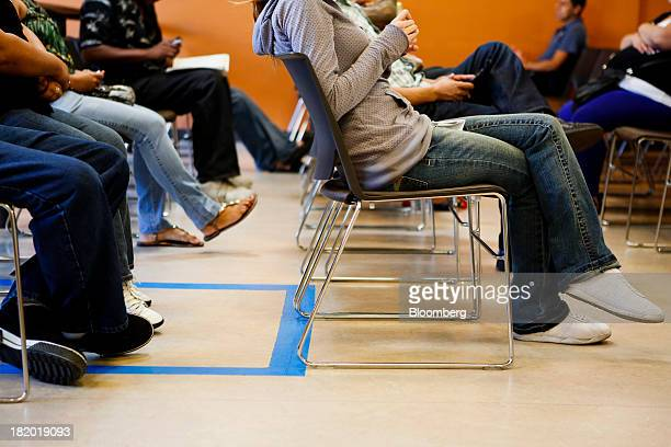 Patients sit in the waiting room at the St John's Well Child and Family Center in Los Angeles California US on Tuesday Sept 24 2013 Workingage...