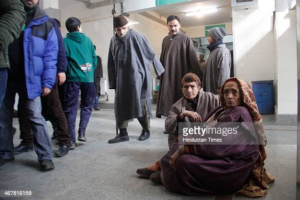 Patients sit outside the out patient department as they wait for treatment during a protest against state Health minister Shabir Ahmed Khan after a...