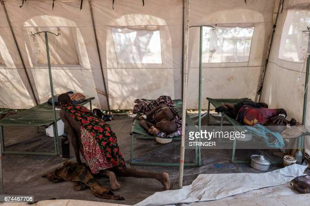 TOPSHOT Patients suffering from cholera receive treatment inside a tent converted into a temporary field hospital near the remote village of Dor in...