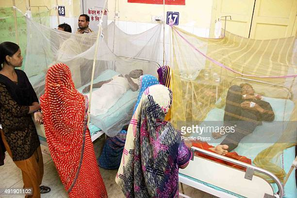 Patients suffering from dengue fever and malaria being treated in an emergency ward at city Hospital The government launched a program of fogging to...