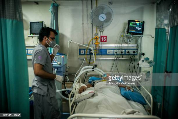 Patients suffering from the Covid-19 coronavirus and who are in serious health condition are being treated inside an intensive care unit ward of a...