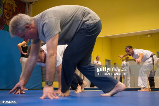Patients suffering Parkinson's disease practice during a lesson of Brazilian Capoeira a mixture of dance and martial art inherited from the times of...