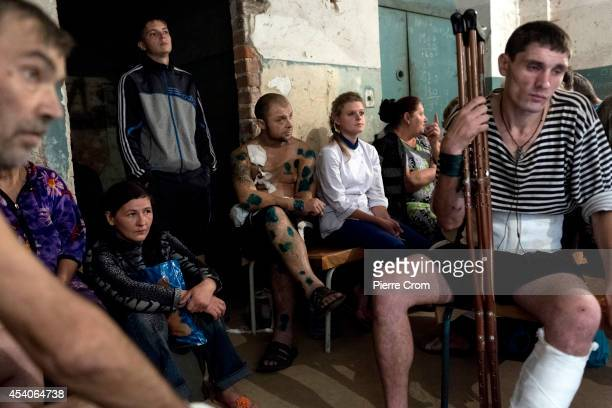 Patients take cover in the basement of a hospital after it was hit by early morning artillery fire on August 24 2014 in Donetsk Ukraine In the last...