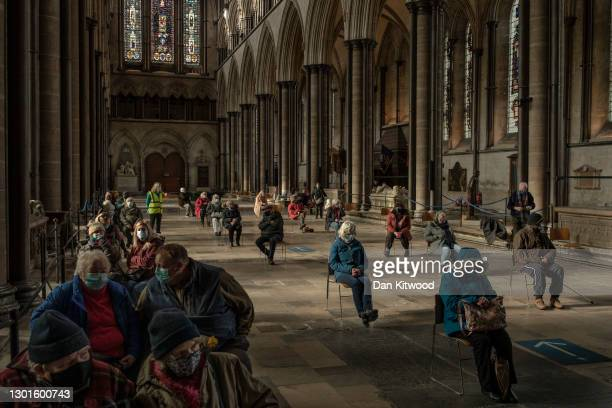 Patients wait after receiving their Covid-19 jabs at a vaccination centre at Salisbury Cathedral on February 11, 2021 in Salisbury, England. Over 13...