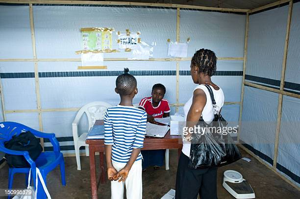 Patients wait at the Wellington Cholera Treatment Unit in Freetown on August 29 2012 Gripped by its worst cholera outbreak in nearly 15 years which...