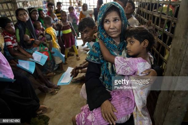 Patients wait for medical treatment in the urgent out patient waiting area at the 'Doctors Without Borders' Kutupalong clinic on October 4 2017 in...