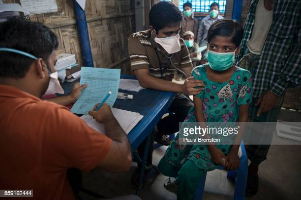 Patients wait for testing and medical treatment for tuberculosis at the 'Doctors Without Borders' Kutupalong clinic on October 4, 2017 in Cox's...
