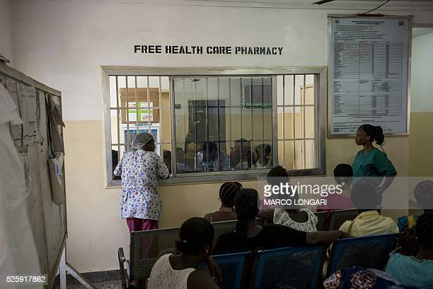 Patients wait for their turn to be served at the pharmacy of the Princess Christian Maternity Hospital in Freetown on April 25 2016 With the head...