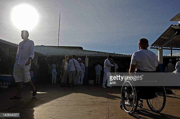 Patients wait for their turn to be treated at the 'Casa de Dom Inacio de Loyola' in Abadiania 120km southwest of Brasilia state of Goias on April 4...