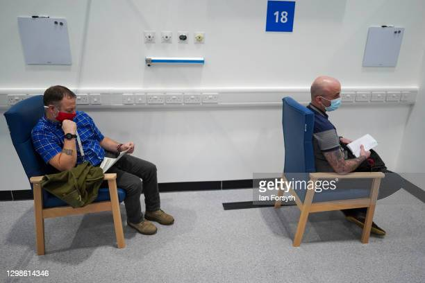 Patients wait in a post vaccine observation area after receiving their AstraZeneca/Oxford University Covid-19 Vaccines on January 26, 2021 in...