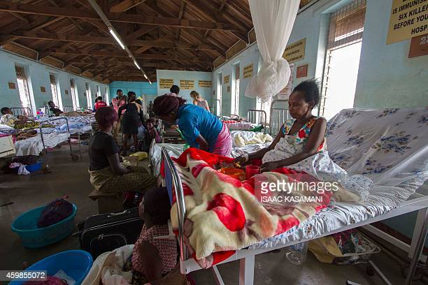 Patients wait in a ward prio to undergo obstetric fistula repair surgery at the Mulago Hospital in Kampala on October 31, 2014. Millions of women in...