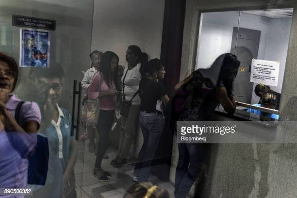 Patients wait in line to see the receptionist at a public hospital in Lechera Venezuela on Wednesday Aug 23 2017 The ruling party'slandslide...