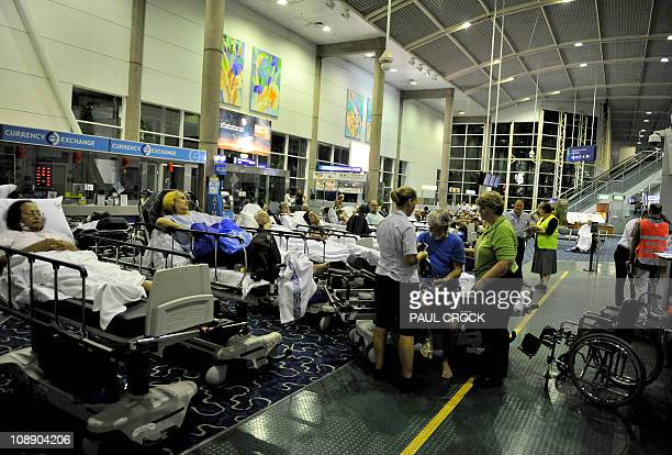 Patients wait in the International Terminal Building before being loaded onto Royal Australian Air Force C17 and C130 aircraft as hospitals are being...