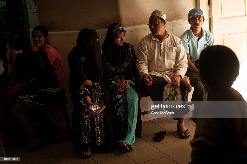 Patients wait to be seen by a doctor at the Free Muslim Hospital on February 13, 2013 in Yangon, Burma. The Free Muslim Hospital was established in 1937, the 66 doctors on the roster see an average of 400 patients a day. As the country goes through sweeping political and economic reforms, many are hopeful that after decades of neglect the healthcare system will also benefit from the changes. Although health budgets have increased the state health system is still underfunded and struggles to provide basic healthcare as well as essential medicines for treating HIV, Malaria and TB. With sanctions being lifted it is hopeful that again the flow of medical equipment, medicines and the presence of NGO's will increase.