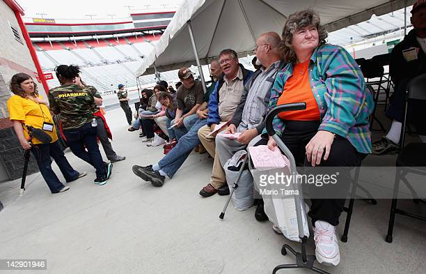 Patients wait to have teeth extracted during the Remote Area Medical free clinic at the Bristol Motor Speedway located in the mountains of Appalachia...