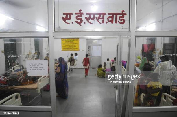Patients waiting at AES ward at Babu Mohan Singh district hospital on August 14 2017 in Deoria India More than 60 children have reportedly died at...