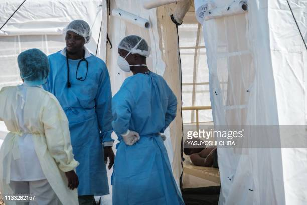 Patients who has diarrhea are accomodated in a treatment tent at Macurungo urban healt center in Beira on March 27 2019 as five cases of cholera have...