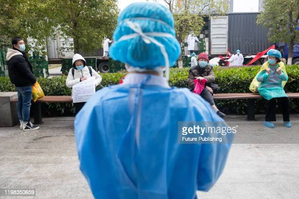 WUHAN CHINA FEBRUARY 2 2020 Patients who have completed the discharge procedures are waiting for the bus to leave Jinyintan hospital Wuhan City Hubei...