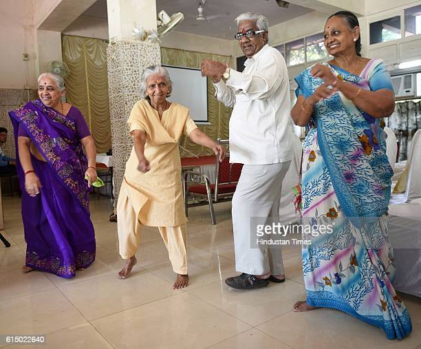 Patients who have undergone joint replacement surgeries recently take center stage at the Garba event on the World Arthritis Day at Kalidas Natya...