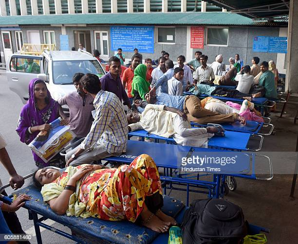 Patients with fever suspected to be suffering from chikungunya or dengue await for medical treatment outside the AIIMS hospital on September 15 2016...