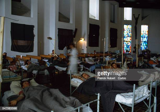Patients wounded in the Yugoslavian Civil War recover in a makeshift hospital set in a converted church in the Croatian enclave of Nova Bila in...
