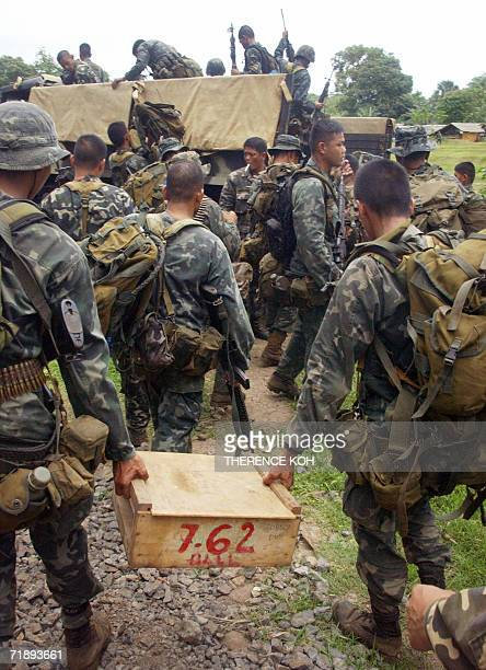 Combat troops from Philippine Marines carrying ammunition supply prepare for deployment into the frontlines in Patikul in southern Jolo island 14...