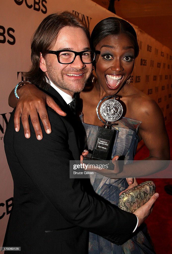 Patina Miller (R), winner of the award for Best Performance by a Leading Actress in a Musical for 'Pippin' poses with David Mars in The 67th Annual Tony Awards at Radio City Music Hall on June 9, 2013 in New York City.