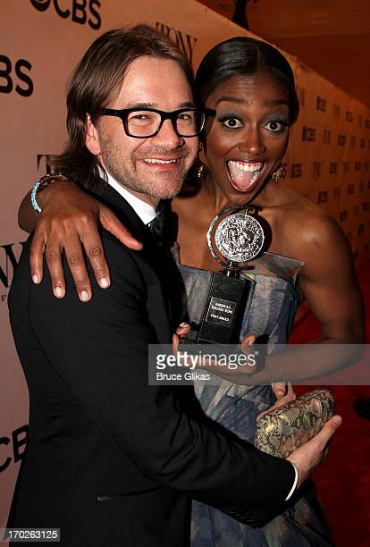 Patina Miller winner of the award for Best Performance by a Leading Actress in a Musical for 'Pippin' poses with David Mars in The 67th Annual Tony...