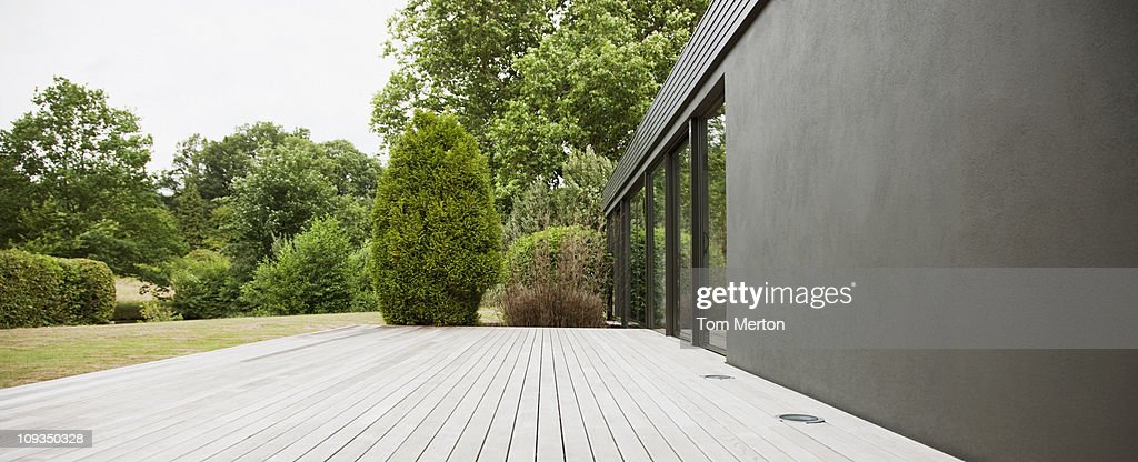 Patio and backyard of modern house : Stock Photo