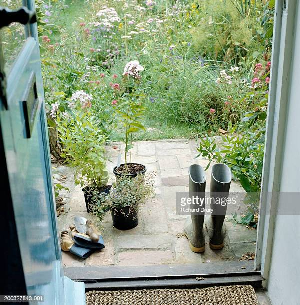 patio and garden, view through door - richard drury stock pictures, royalty-free photos & images