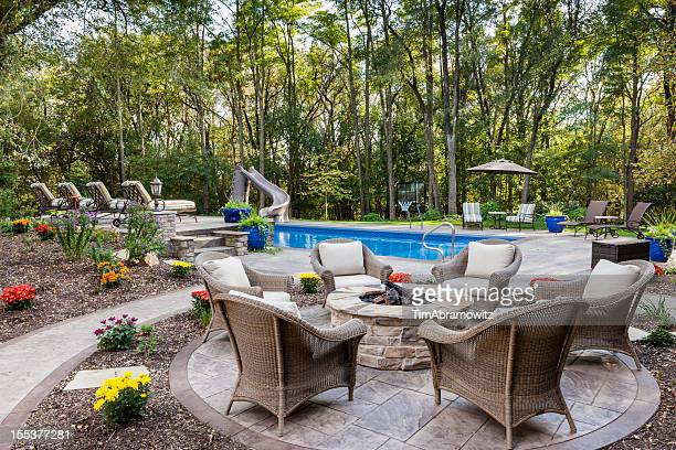 patio fire pit by swimming pool - fire pit stock pictures, royalty-free photos & images