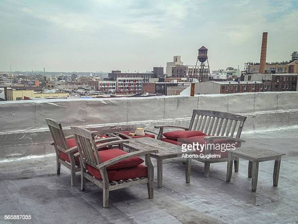 Patio furniture on urban rooftop