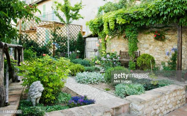 patio garden - paving stone stock pictures, royalty-free photos & images